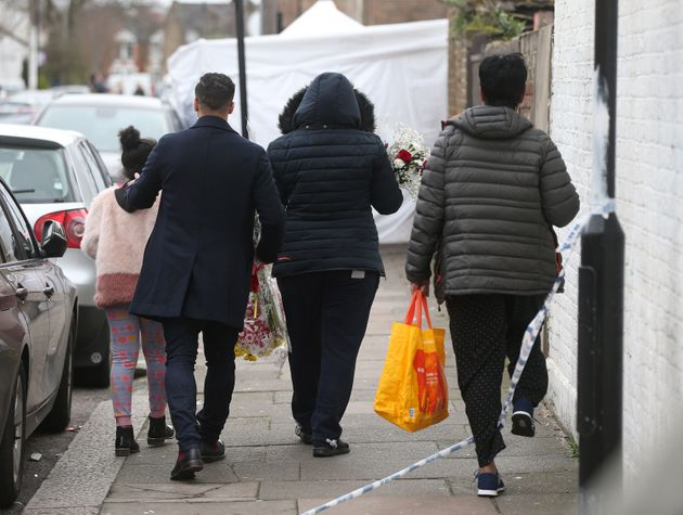 People thought to be friends and family lay flowers at the scene Chalgrove Road in Tottenham, north London,...