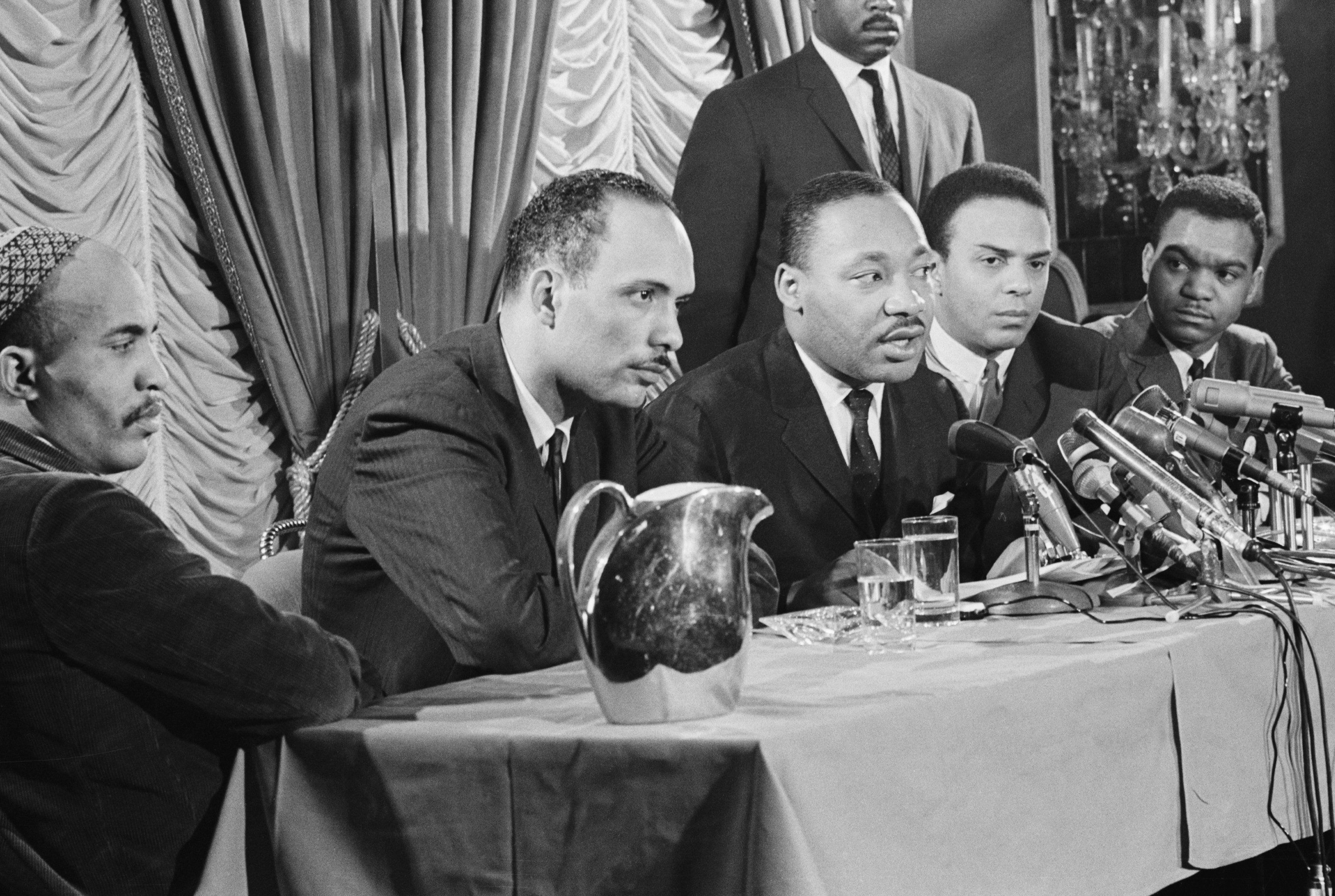 Dr. Martin Luther King Jr., center, announcing on Jan. 7, 1966, a freedom movement to be launched in Chicago.