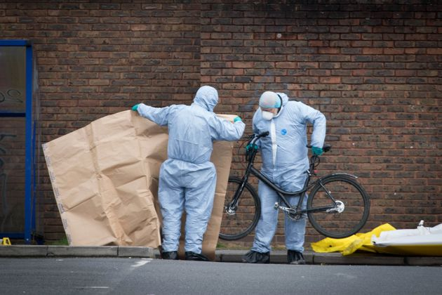 Forensic officers at the scene where a 16-year-old boy was shot on Monday evening in Walthamstow, east London.
