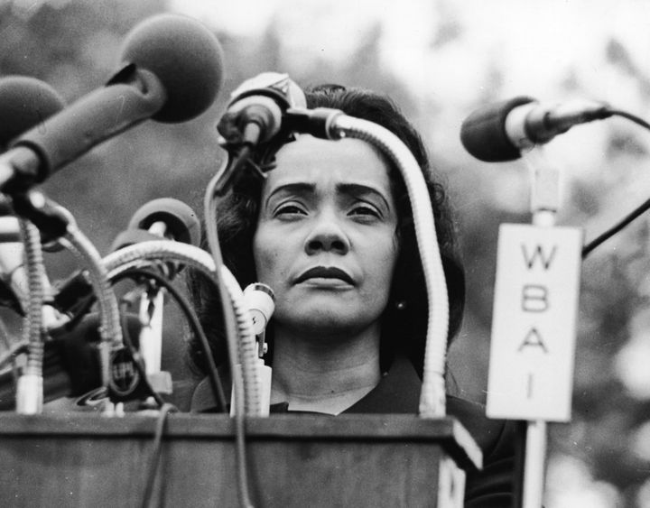 Martin Luther King's widow, Coretta Scott King, at a lectern covered in microphones during an antiwar rally in New York's Cen