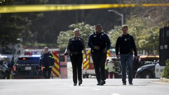 SAN BRUNO, CA - APRIL 03:  Police walk outside of the YouTube headquarters on April 3, 2018 in San Bruno, California. Police are investigating an active shooter incident at YouTube headquarters that has left at least one person dead and several wounded.  (Photo by Justin Sullivan/Getty Images)