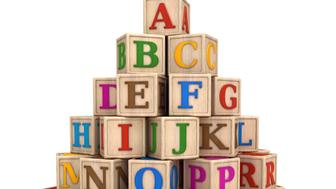 'Stack of alphabet letters , baby toys, wooden blocks.Digitally generated image.'