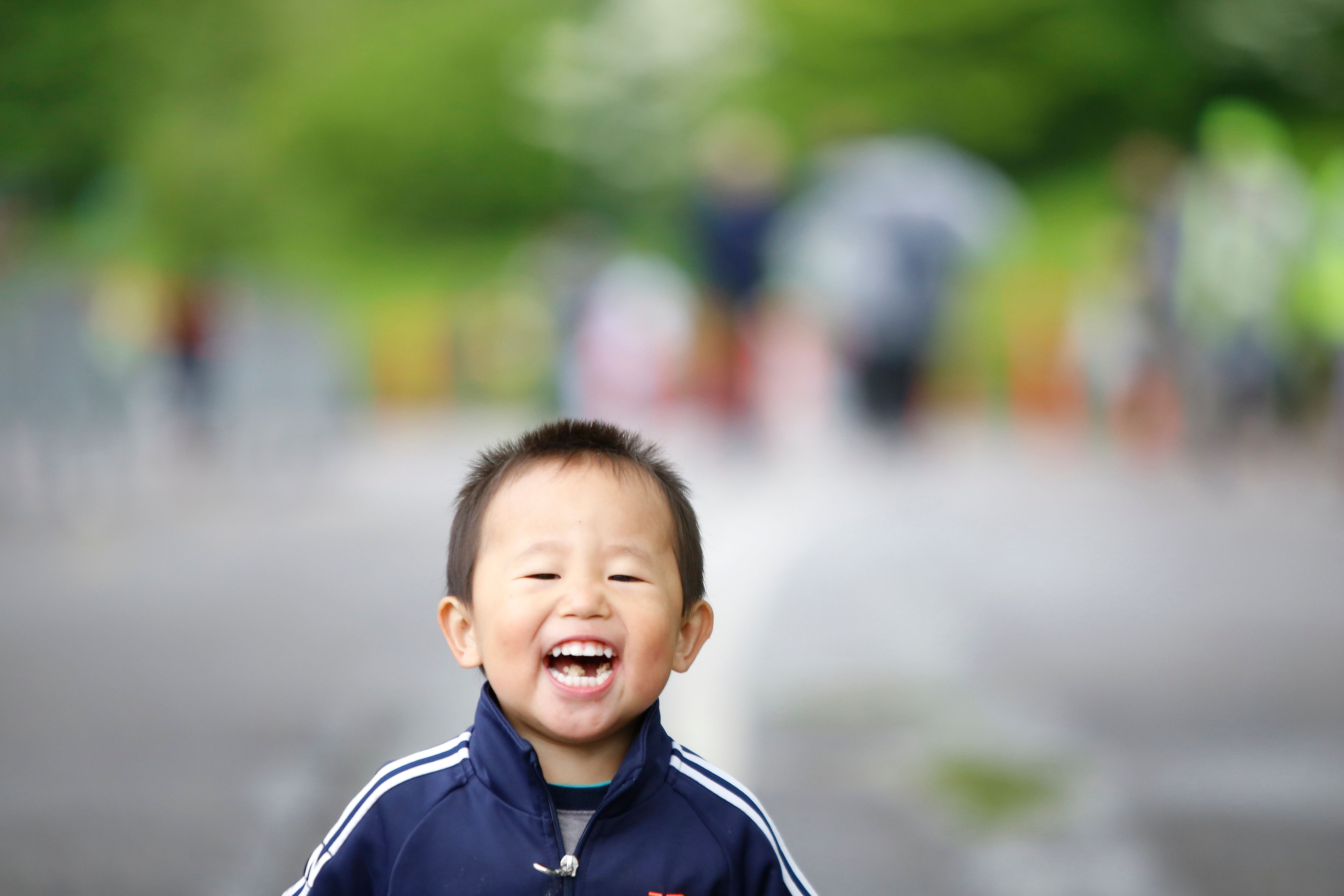 MANHATTAN, NEW YORK CITY, UNITED STATES - 2016/05/08: Toddler joyful at completing first leg of race solo. Early am rain abated in time for the tenth annual Japan Day in Central Park that included a Kids' Run sponsored by New York Road Runners, exhibits of Japanese craft & food. (Photo by Andy Katz/Pacific Press/LightRocket via Getty Images)