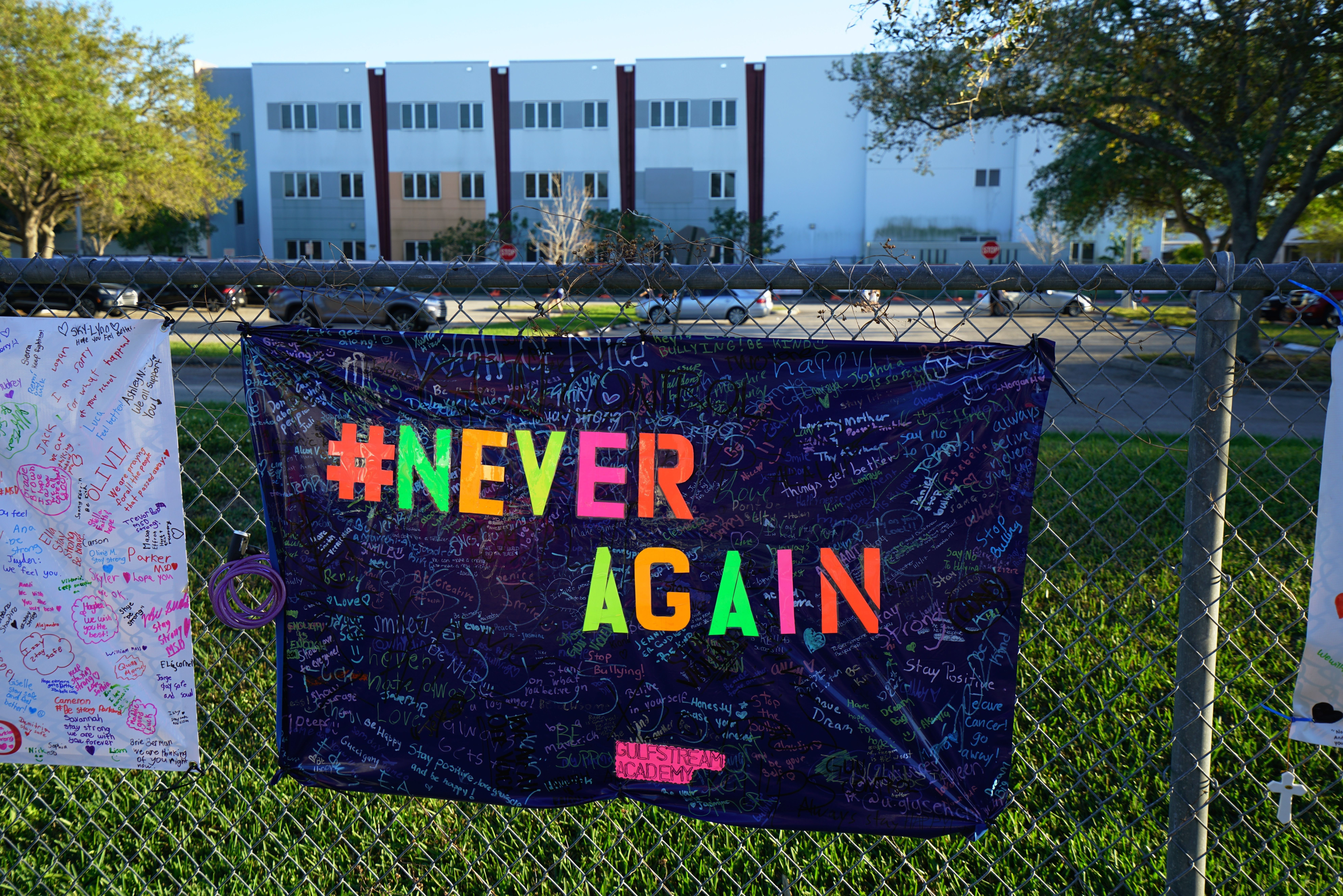MARJORY STONEMAN DOUGLAS HIGH SCHOOL, PARKLAND, FLORIDA. 02/25/2018 In the background, the school building, now slated to be demolished, where 17 children and teachers were killed by lone gunman Nikolas Cruz.  On February 14, 2018, a former school  Stoneman Douglas student Nikolas Cruz entered the school at 2.30pm and proceeded to kill 3 teachers and 14 school children in a 7 minute shooting spree. Marjory Stoneman Douglas High School is located in Parkland, Florida, in the Miami metropolitan area. It is a part of the Broward County Public School district, and it is the only public high school in Parkland. (Photo by Giles Clarke/Getty Images)