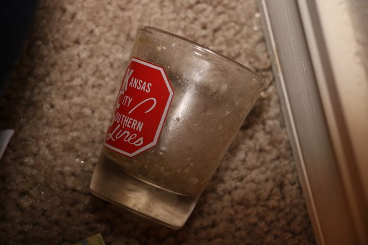 A shot glass found in Shawn Arthur's apartment contained the remains of a powdery substance, police said.