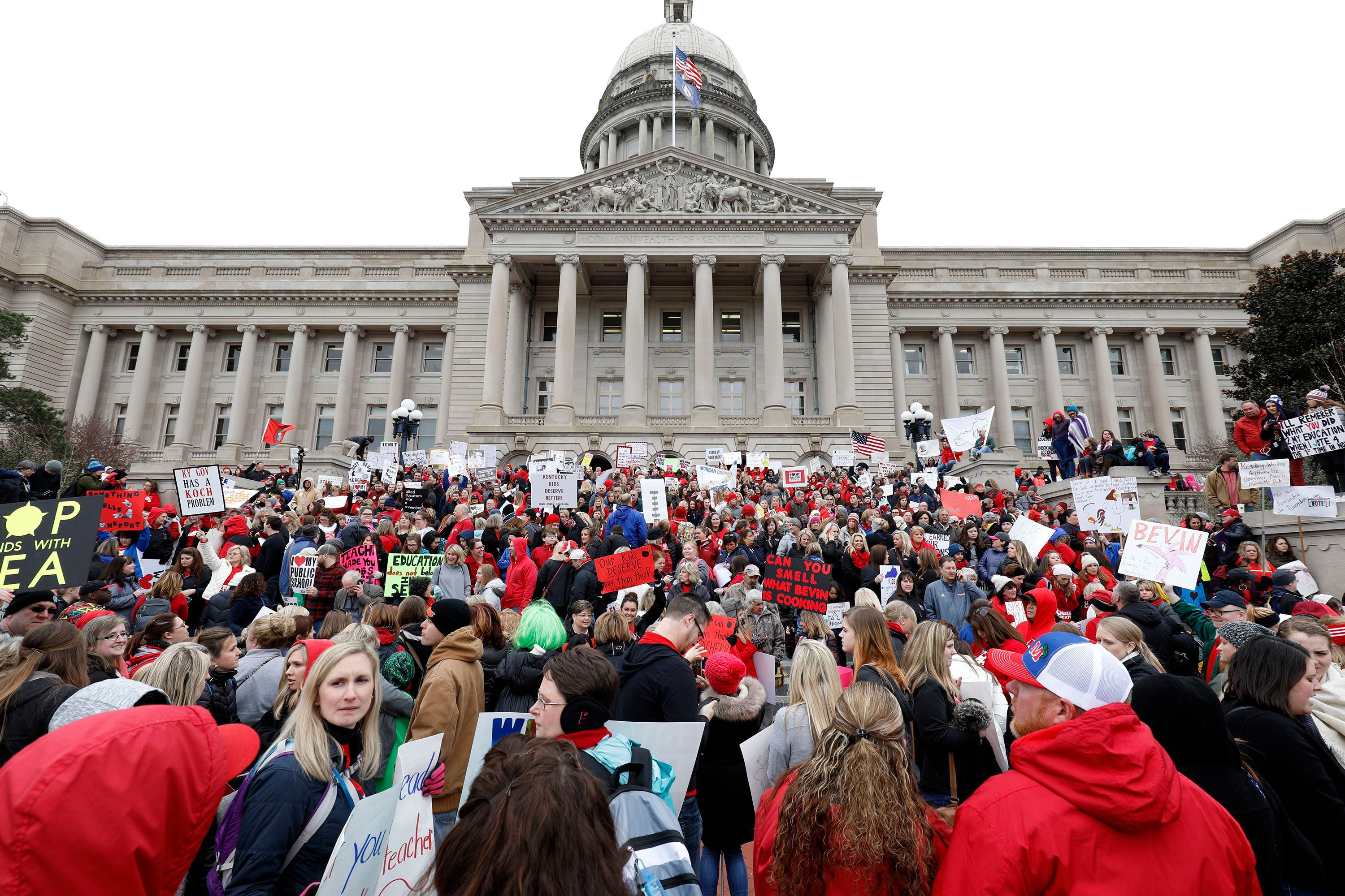 FRANKFORT, KY - APRIL 2: Thousands of public school teachers and their supporters protest against a pension reform bill at the Kentucky State Capitol April 2, 2018 in Frankfort, Kentucky. The teachers are calling for higher wages and are demanding that Kentucky Gov. Matt Bevin veto a bill that overhauls their pension plan. (Photo by Bill Pugliano/Getty Images)