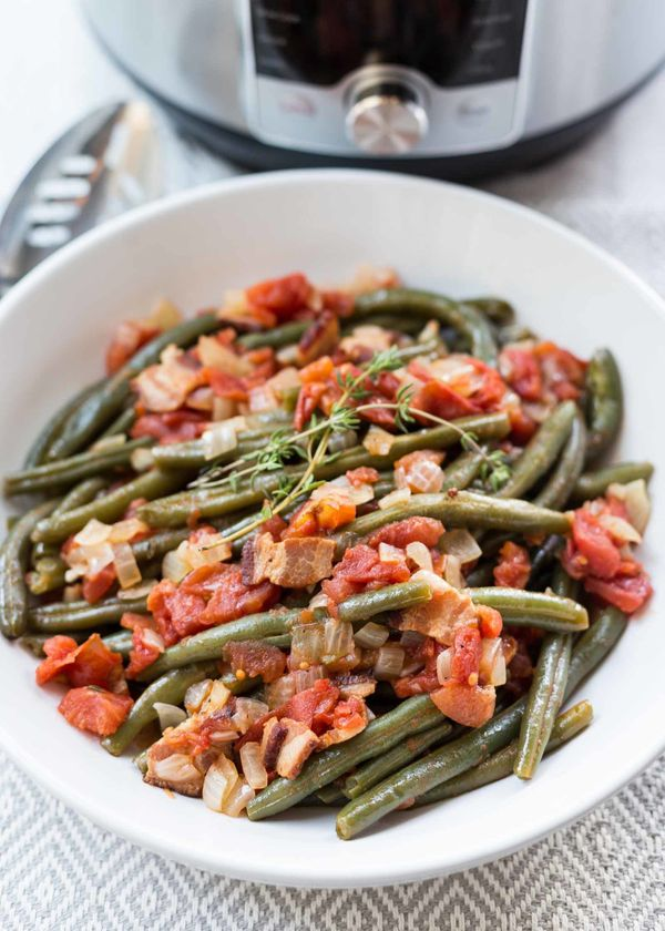 """<strong>Get the <a href=""""https://www.simplyrecipes.com/recipes/pressure_cooker_green_beans_with_tomatoes_and_bacon/"""" target="""""""