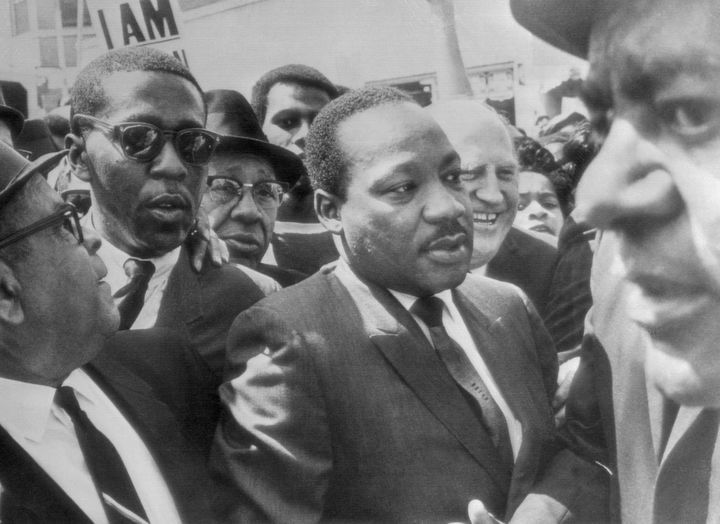 Dr. Martin Luther King, center, is surrounded by leaders of the sanitation strike as he arrived in Memphis, Tennessee, to lea