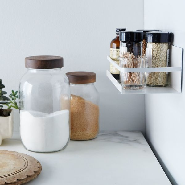 This simple and minimalist spice rack is ideal for folks with very little space who want versatility. Though it can be used f