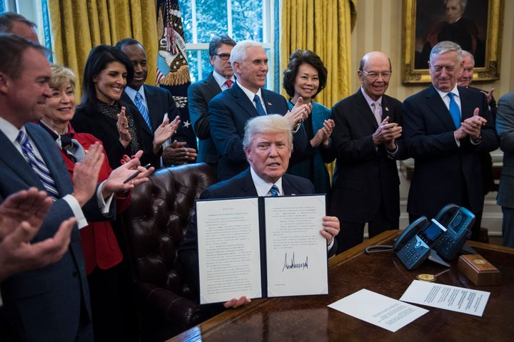 Trump surrounded by members of his cabinet in March 2017.