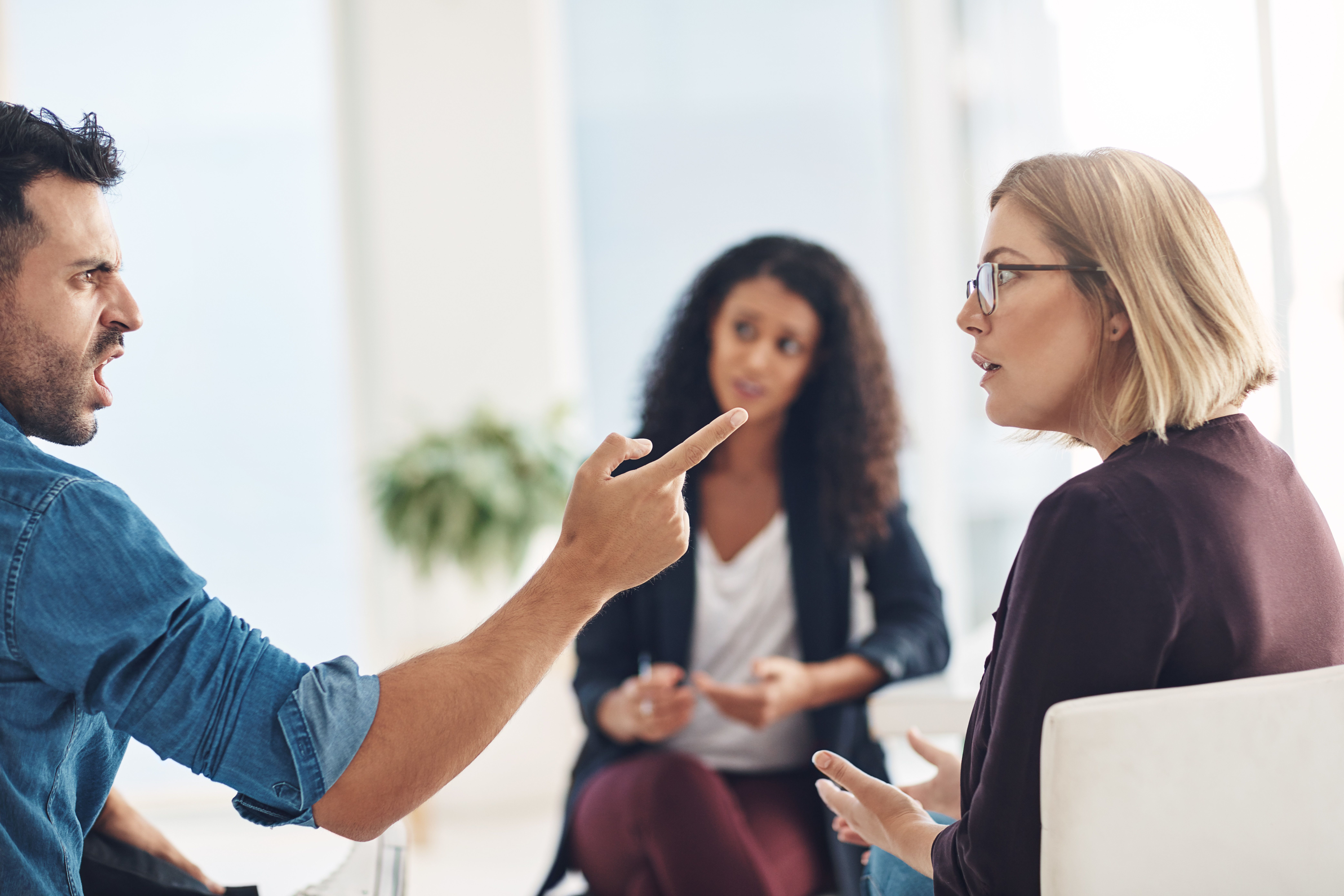 Shot of a couple having an argument during a counseling session with a therapist