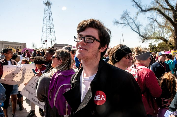 Cameron Olbert, a sophmore at Classen School of Advanced Studies, stands in front of the Oklahoma state capitol on the third