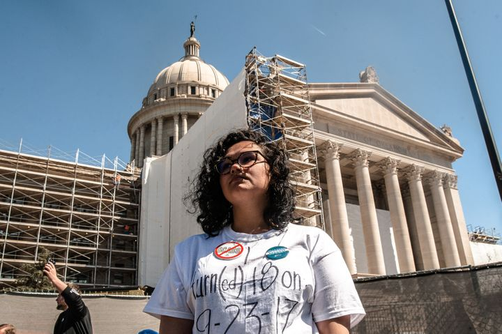 Gabrielle Davis, a senior at Edmond Memorial Highschool, stands in front of the Oklahoma state capitol on the third day of a