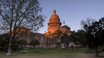 The Texas State Capitol building stands in Austin, Texas, U.S., on Tuesday, March 14, 2017. Austin has spent the last 10 months engaged in a big experiment in urban transportation. Several hundreds of thousands of people will descend upon Austin for the annual South by Southwest festival, a nine-day event that could be described as a tech conference, a music and film festival. Photographer: David Paul Morris/Bloomberg via Getty Images