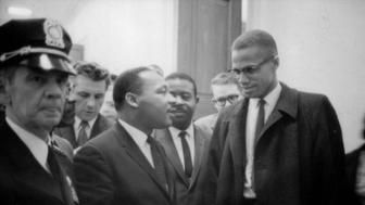 UNSPECIFIED - CIRCA 1754: Martin Luther King Jnr (1929-1968) and Malcolm X (Malcolm Little - 1925-1965) waiting for a press conference, 26 March 1964. Photographer: Marion S.Trikoskor. (Photo by Universal History Archive/Getty Images)