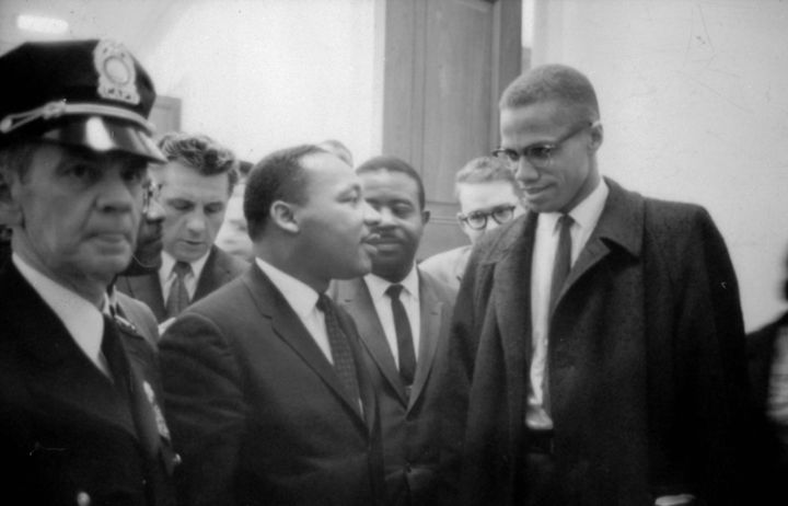 Martin Luther King Jr. and Malcolm X waiting for a press conference on March 26, 1964.