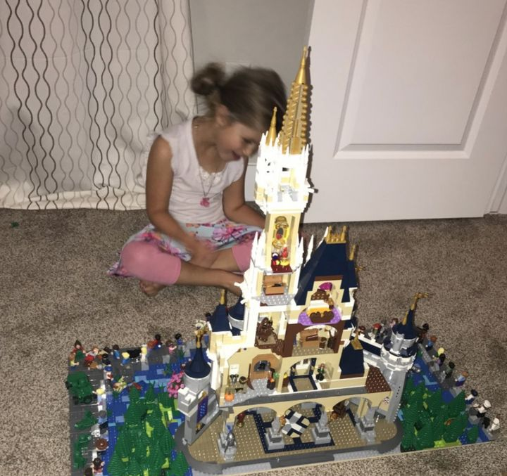 The author's middle daughter, 4 at the time the photo was taken, playing with a new Disneyland Lego castle in