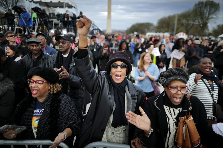 Marchers participate in an anti-racism rally in Washington, D.C., on Wednesday, the 50th anniversary of Martin Luther Ki