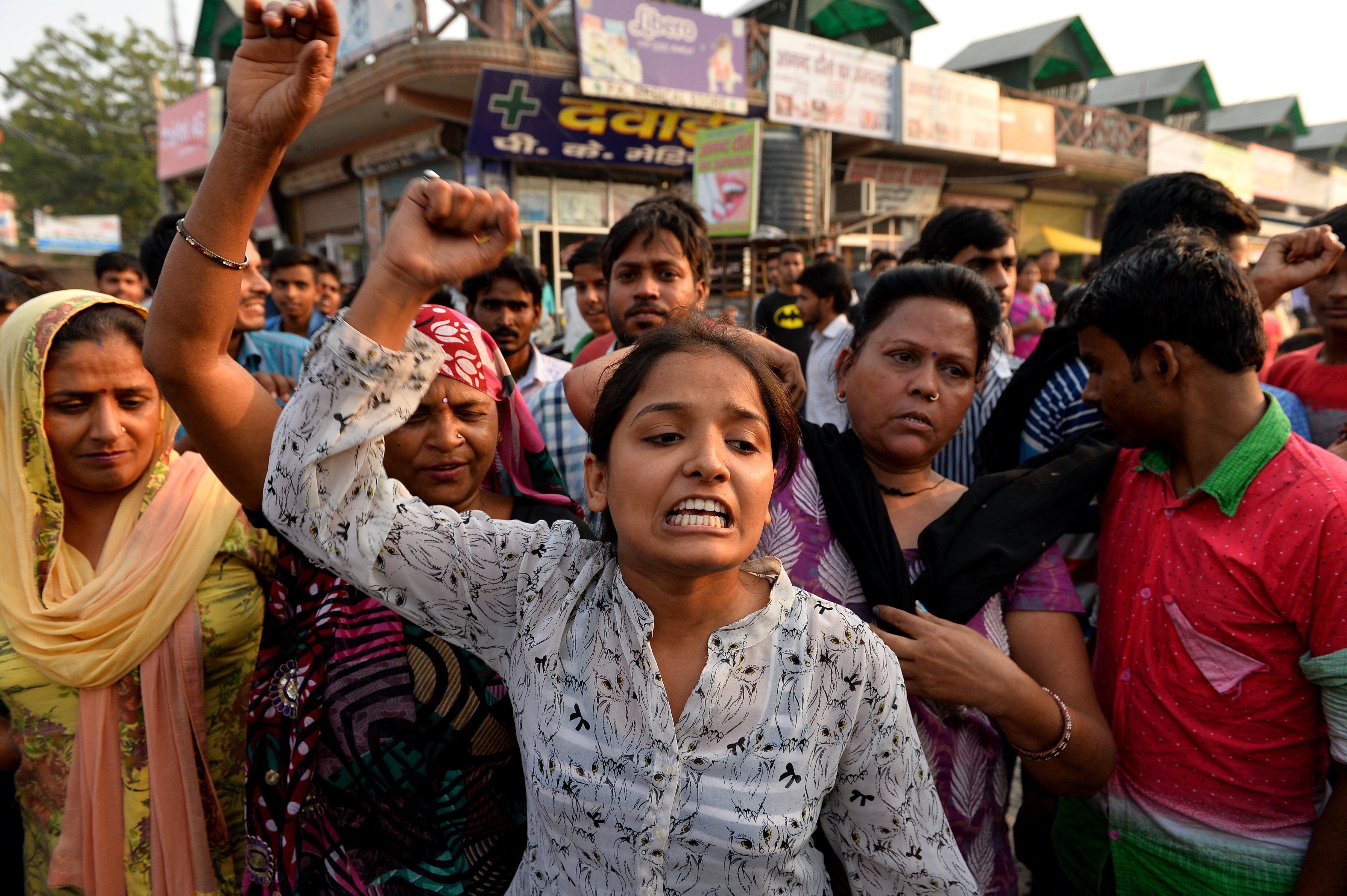 Indian protesters shout slogans during a demonstration near the home of a minor girl who was raped in New Delhi on October 17, 2015. A toddler and a five-year-old girl were raped in separate attacks in New Delhi overnight with at least one gang-raped, police said October 17, as activists warned of an 'epidemic' of sexual violence in the capital. The two-and-a-half-year-old girl was abducted from a religious event in west Delhi by two men on the night of October 16 and raped before being dumped in a park near her home, relatives and police said. In a separate incident on the other side of the city, the five-year-old was lured to a neighbour's house and raped by three men, a police officer told AFP. AFP PHOTO / Chandan KHANNA        (Photo credit should read Chandan Khanna/AFP/Getty Images)