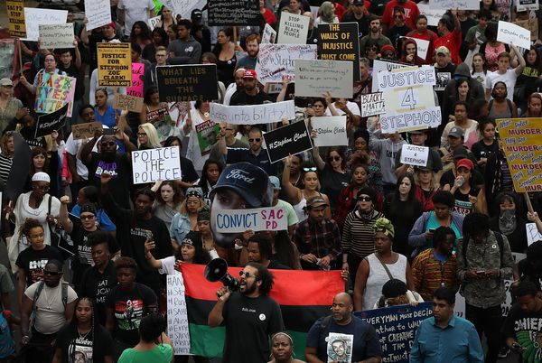 Black Lives Matter protesters take to the streets of Sacramento during a march and demonstration on the 50th anniversary of M