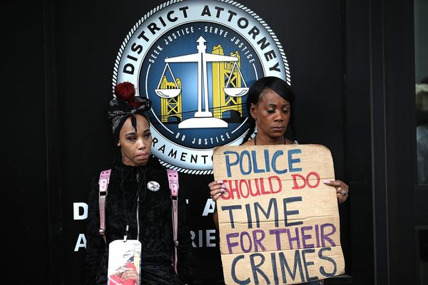 Protesters call for justice for Stephon Clark outside of the Sacramento County districtattorney's office.