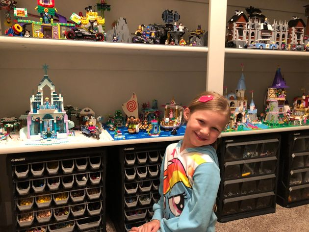Daryl Austin's oldest child, age 7, playing with her Disney Princess and Lego Batman Movie