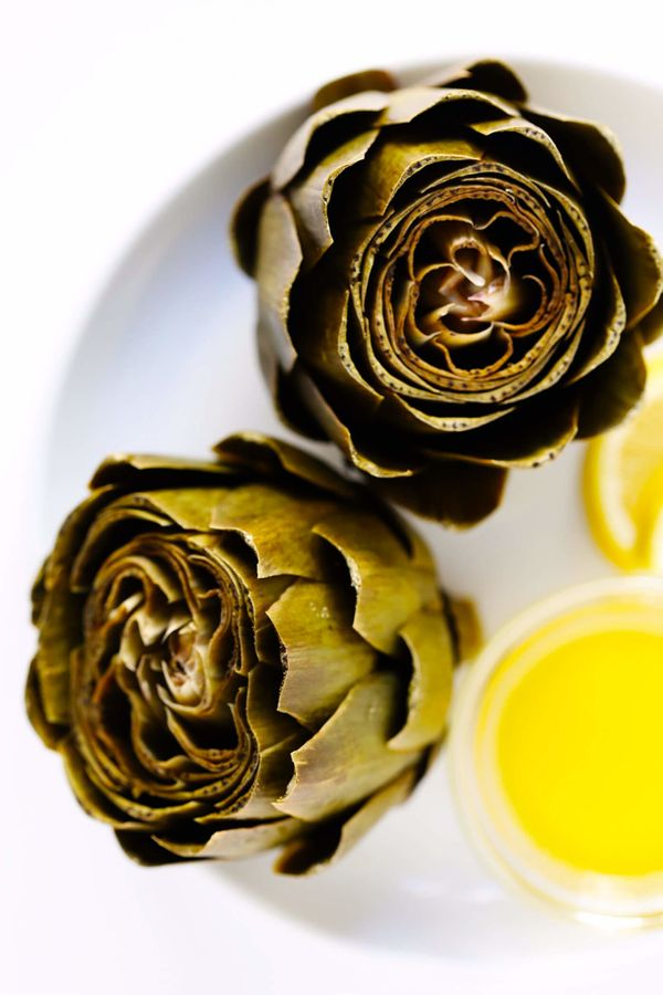 """<strong>Get the<a href=""""https://www.gimmesomeoven.com/instant-pot-steamed-artichokes/"""" target=""""_blank"""">Instant Pot Stea"""
