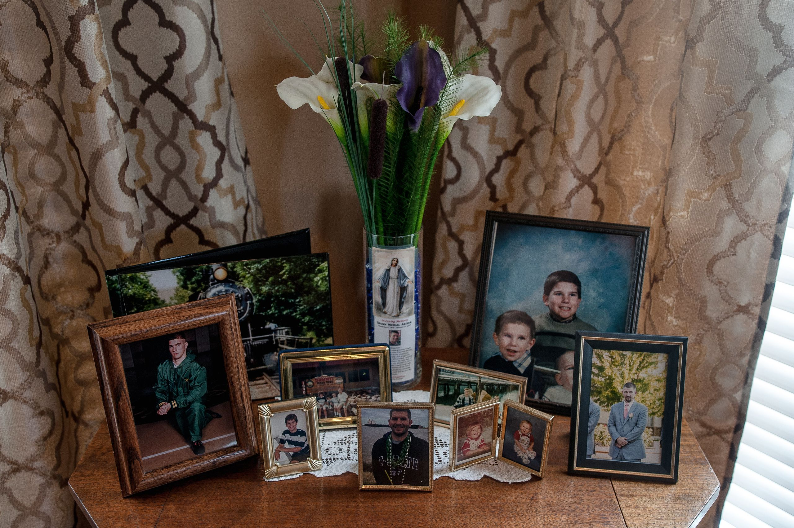A collection of family photos at the Arthur home in Missouri.