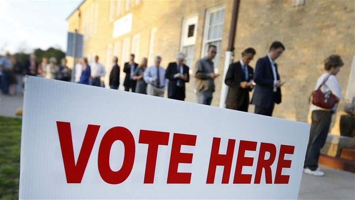 Voters line up to cast their ballots in Fort Worth, Texas. State felon voting laws vary widely, which can create confusion. R