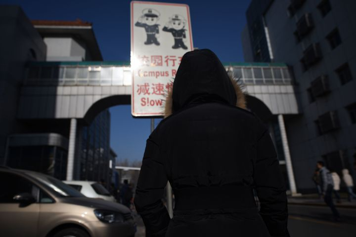 A woman walking at Beihang University in Beijing in January 2018. The university had recently stripped a professor