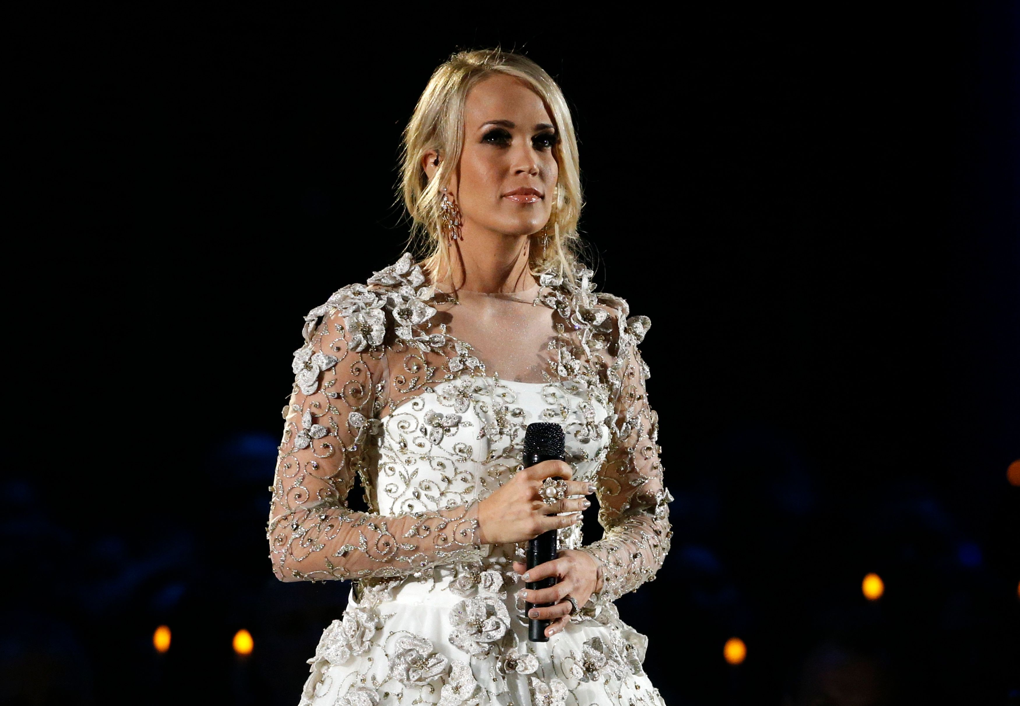 "51st Country Music Association Awards – Show - Nashville, Tennessee, U.S., 08/11/2017 - Carrie Underwood performs ""Softly and Tenderly"" during the in memoriam segment of the show. REUTERS/Mario Anzuoni"