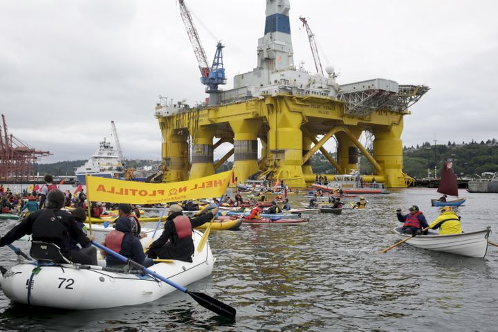 Activists protest the Shell oil drilling rig Polar Pioneer, parked at the Port of Seattle, on May 16, 2015.