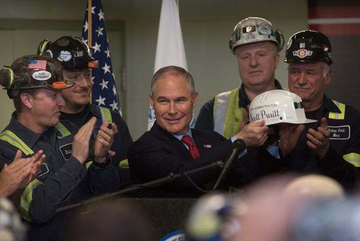 Scott Pruitt holds up a miner's helmet that he was given after speaking with coal miners at the Harvey Mine on April 13, 2017