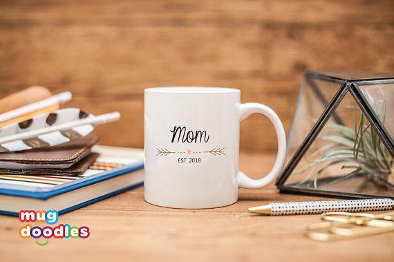 "Get it at <a href=""https://www.etsy.com/listing/494937089/new-mom-mug-new-mom-gift-mom-est-2018?ga_order=most_relevant&ga"