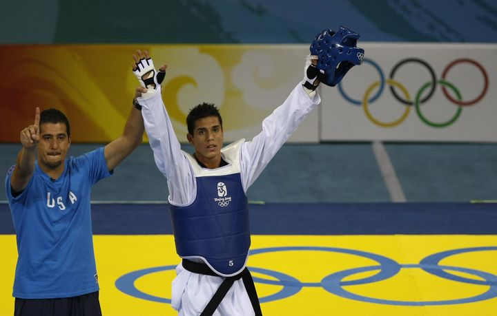 Coach Jean Lopez (left) and his brother Steven Lopez celebrate winning the bronze medal in the men's 80KG taekwondo&nbsp