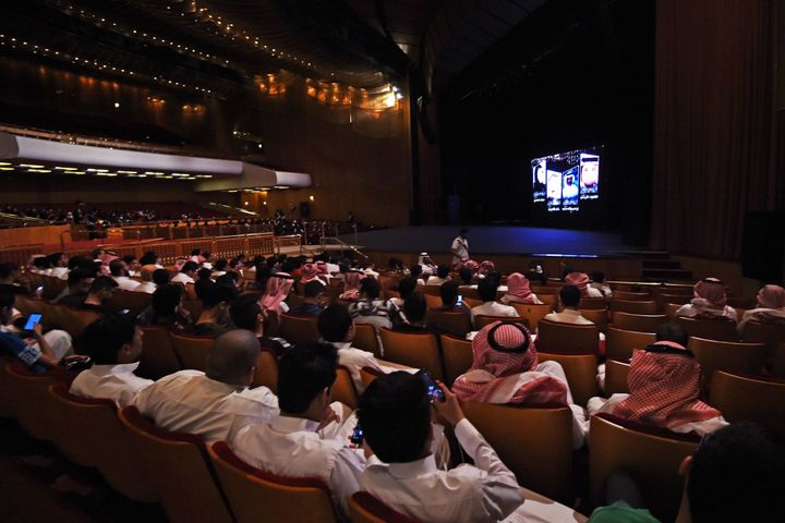 Saudi Arabians attend a film festival at King Fahad Culture Center in Riyadh.