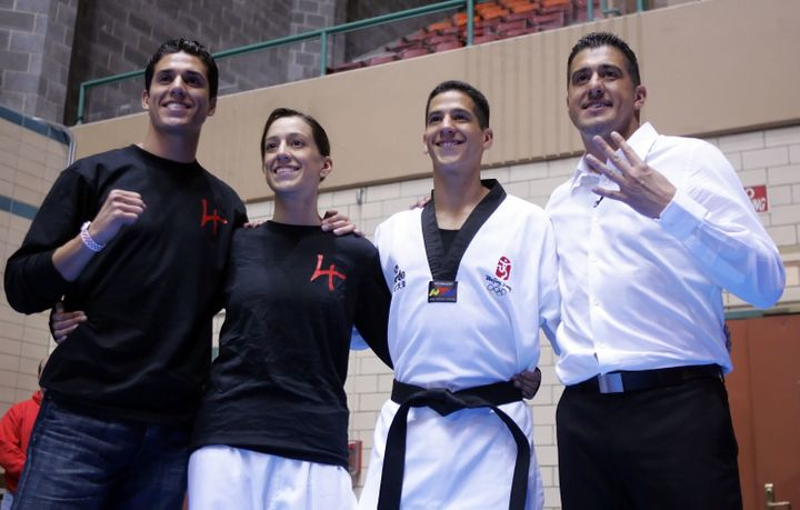 Steven Lopez, Diana Lopez, Mark Lopez and Jean Lopez at the Olympic trials for taekwondo on April 5, 2008, in Des Moines, Iow
