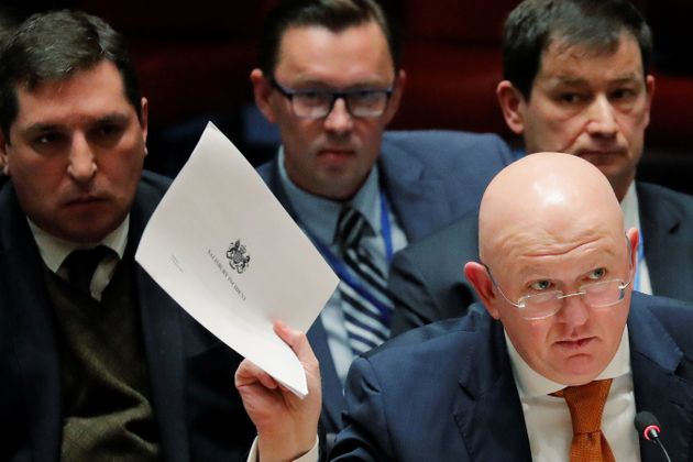 Russian Ambassador to the United Nations, Vasily Nebenzya, holds a copy of a British report on an incident in Salisbury.