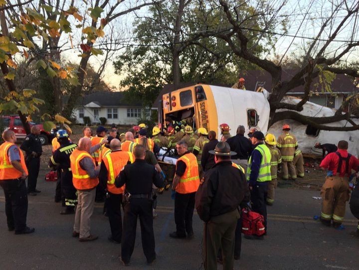 Rescue officials are seen at the scene of a fatal school bus crash in Chattanooga, Tennessee, Nov. 21, 2016.
