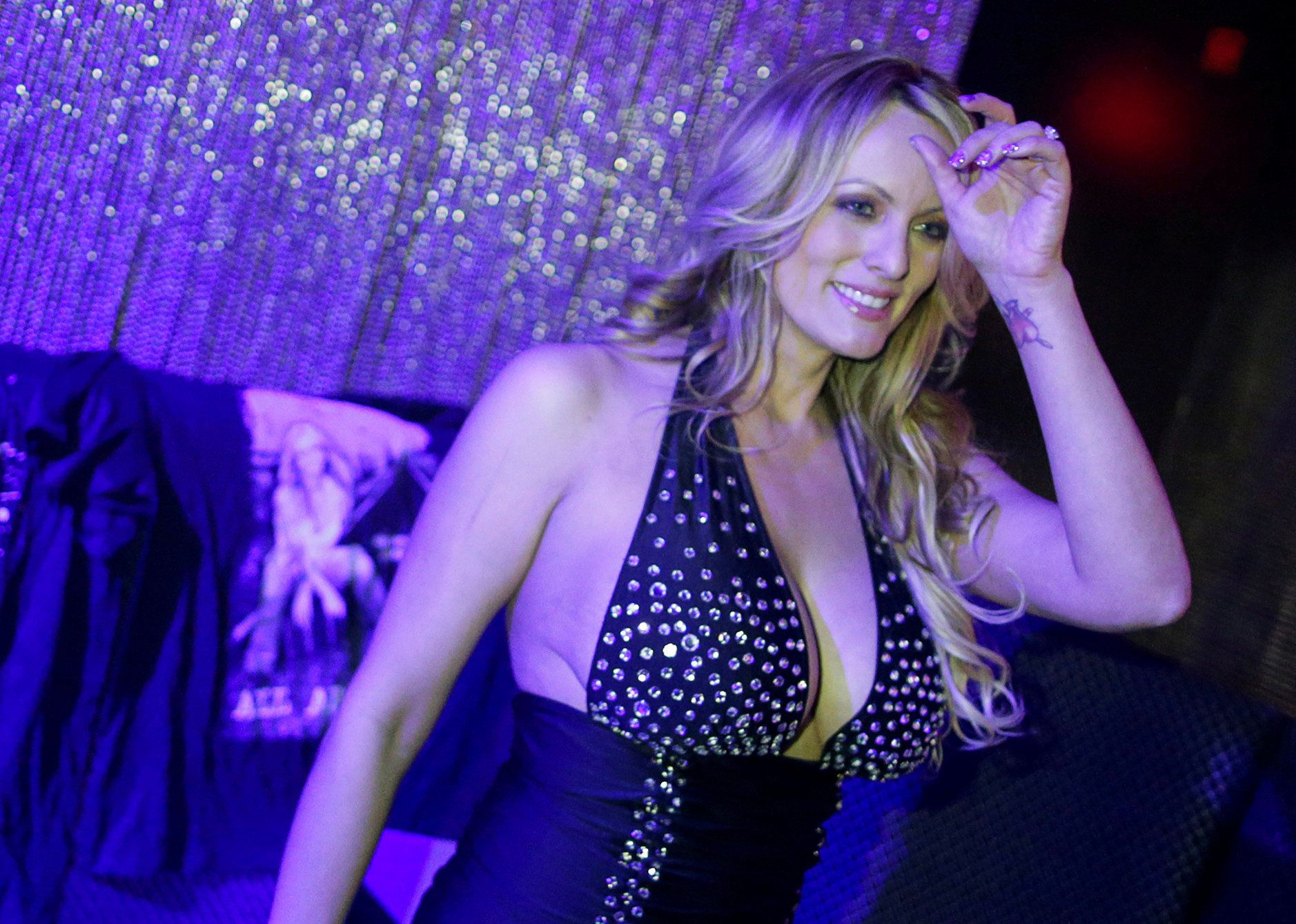 Adult-film actress Stephanie Clifford, also known as Stormy Daniels, poses for pictures at the end of her striptease show in Gossip Gentleman club in Long Island, New York, U.S., February 23, 2018. REUTERS/Eduardo Munoz - RC1FA1ED9330