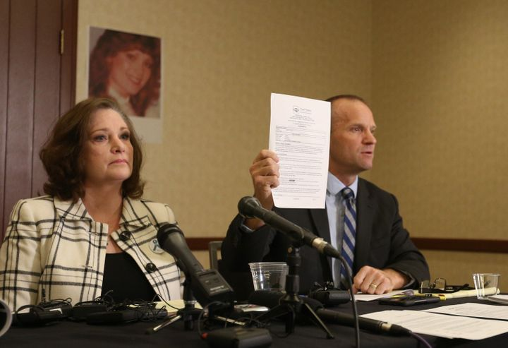 Attorney Craig Vernon holds up the results of his client McKenna Denson's lie detector test. Denson is suing the Church