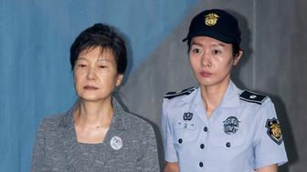 Park Geun-hye, former president of South Korea, (Left), is escorted by prison officer as she arrives at the Seoul Central District Court in Seoul, South Korea on August 25, 2017. Samsungs de facto leader Jay Y. Lee will lean hia fate Friday in a trial that has gripped the nation for six months as part of a wider scandal involving former Park. Photo Credit: Lee Young-ho / POOL (Photo by Seung-il Ryu/NurPhoto via Getty Images)