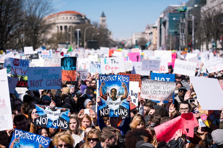 People holding signs filled blocks of Pennsylvania Avenue during March For Our Lives on March 24.