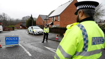 Police officers guard the entrance of the street on which former Russian intelligence officer Sergei Skripal's house is, in Salisbury, Britain March 10, 2018. REUTERS/Peter Nicholls