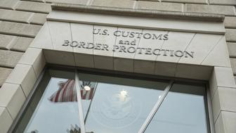 WASHINGTON, USA - MARCH 7: Entrance of the U.S. Customs and Border Protection headquarters is seen as people protest recent Executive Actions and anti-immigrant rhetoric coming from the Trump administration in Washington, USA on March 7, 2017. (Photo by Samuel Corum/Anadolu Agency/Getty Images)