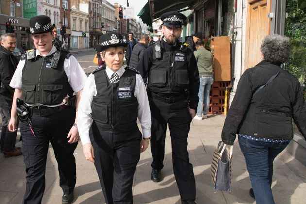 Met Police Commissioner Cressida Dick walks with officers in Stoke Newington, north London, on Friday