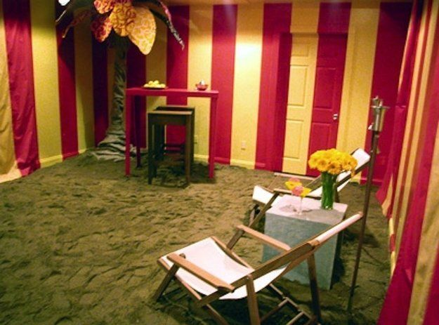 Hildi Santo-Tomas covered a living room floor with sand for a beach getaway theme.