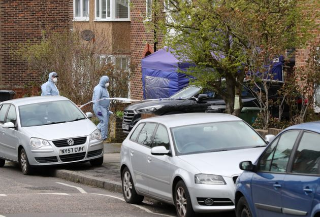 Forensic officers at the scene in South Park Crescent in Hither Green, London, after a pensioner was...