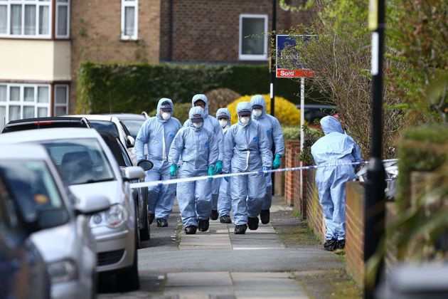 Forensic officers at the scene in South Park Crescent in Hither Green, London.
