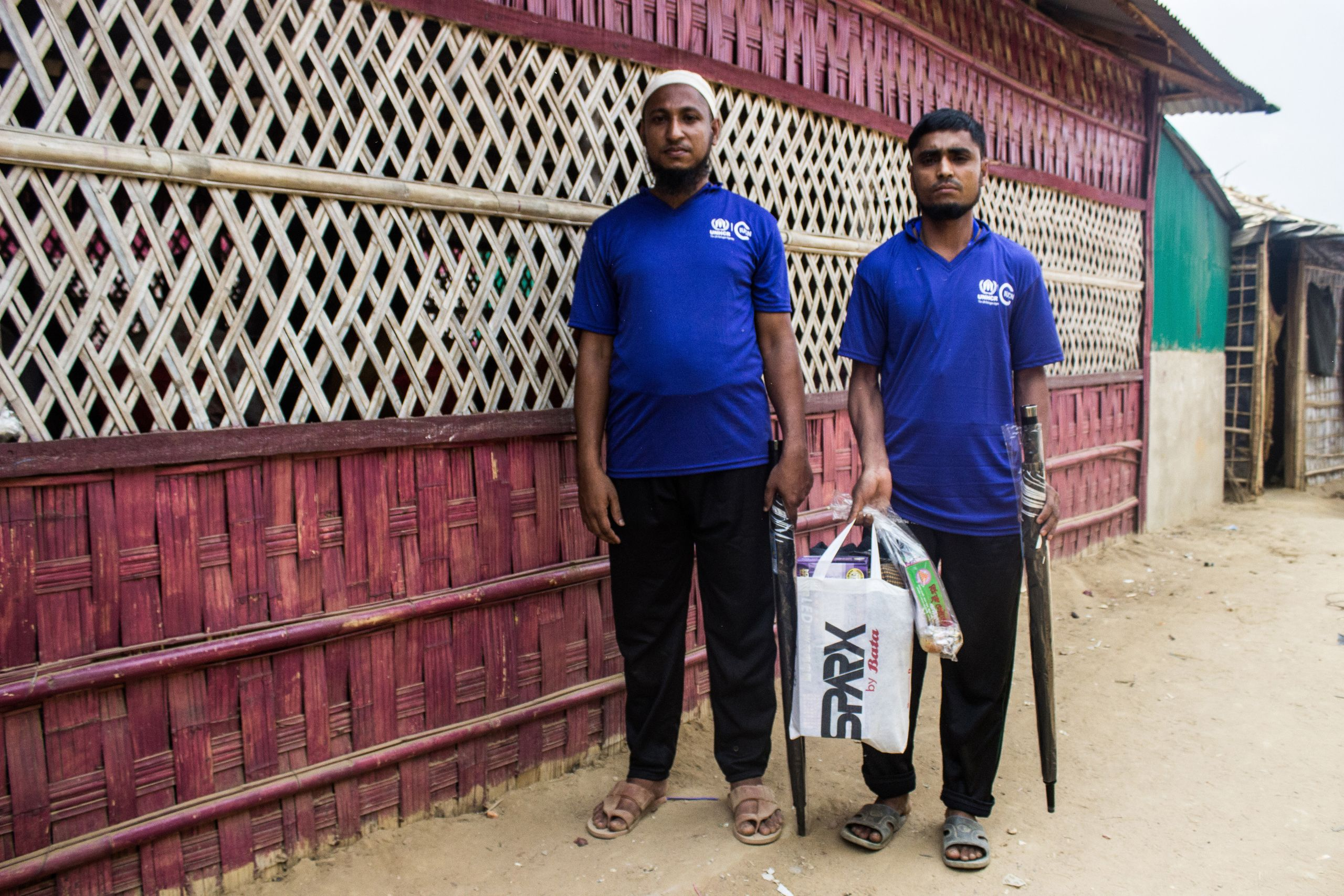 Elephant response team volunteers Jahid Hossain (left) and Mohammed Yahea (right) with equipment given to them by IUCN.